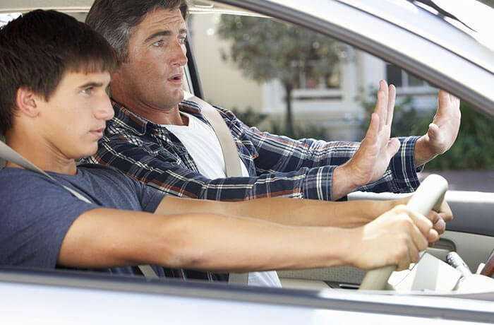 Driving instructor teaching a learner driver