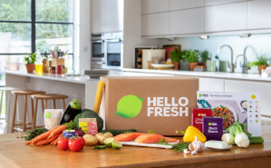 Hello Fresh man in kitchen with box