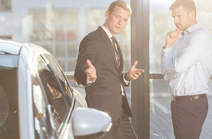 Salesman selling a car