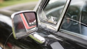 Close up of a wing mirror on a classic car