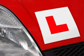A close up of an L plate on a car