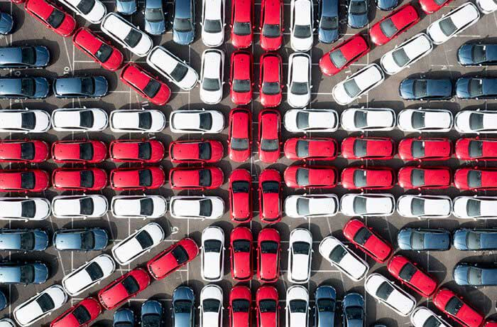 A Union Jack made up of different coloured Vauxhall Astra cars