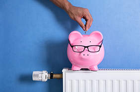 piggy bank on radiator - energy efficiency saving money
