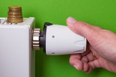 Saving energy by turning down the thermostat