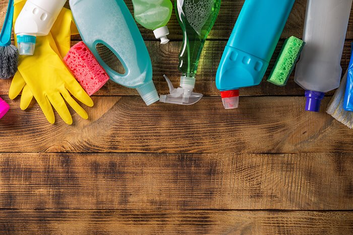 Cleaning products on a wooden background