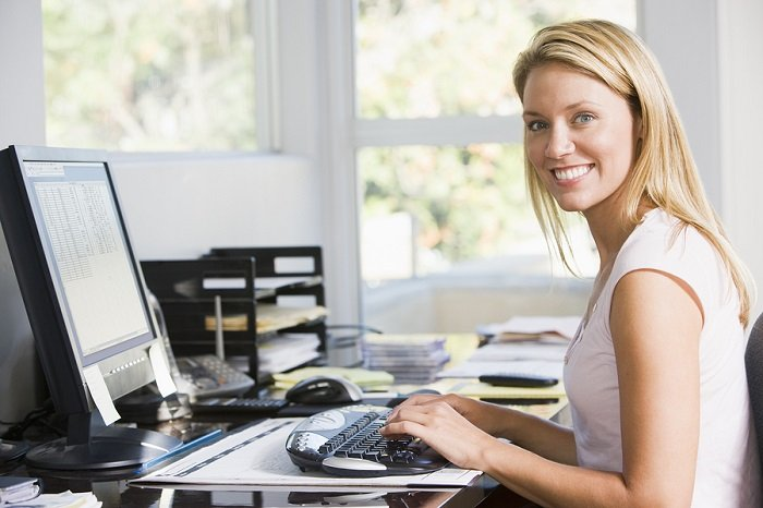 Woman working at home office desk