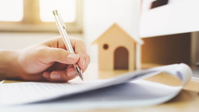 Person looking through a mortgage document