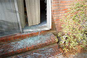 Patio door with broken glass