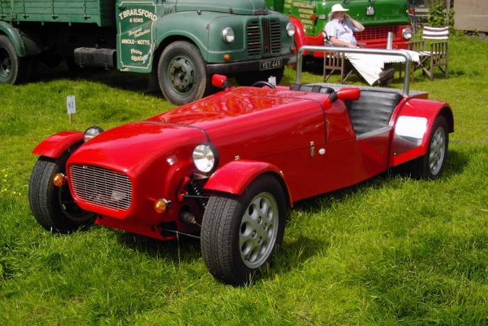 A red kit car on the grass