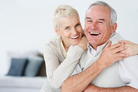 Retired elderly couple smiling