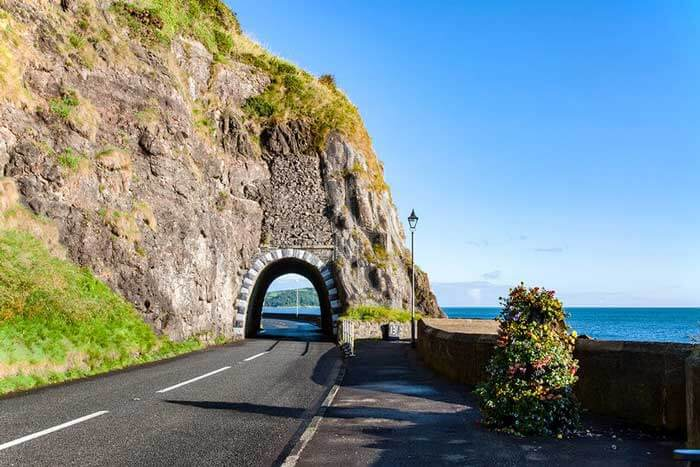 Antrim coast road with a tunnel through a hillside