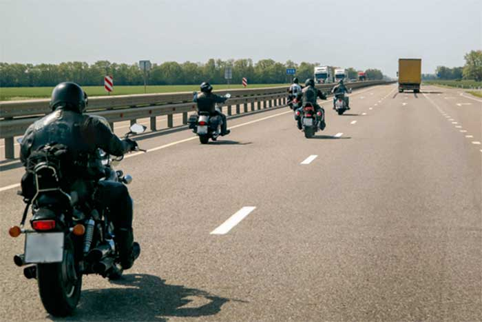 Four motorbikes driving down the motorway