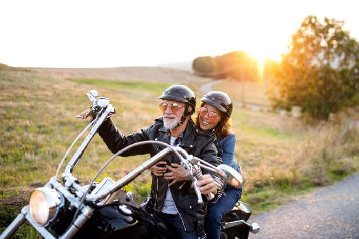 older couple riding cruiser motorbike