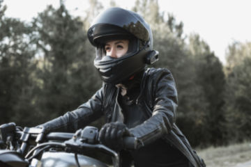 Someone wearing biking helmet and leathers riding a motorbike