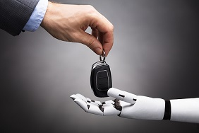 Man handing car keys to robot