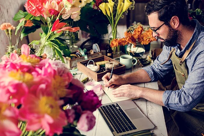 Self-employed florist with laptop