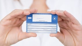 A close up of someone holding the european health insurance card