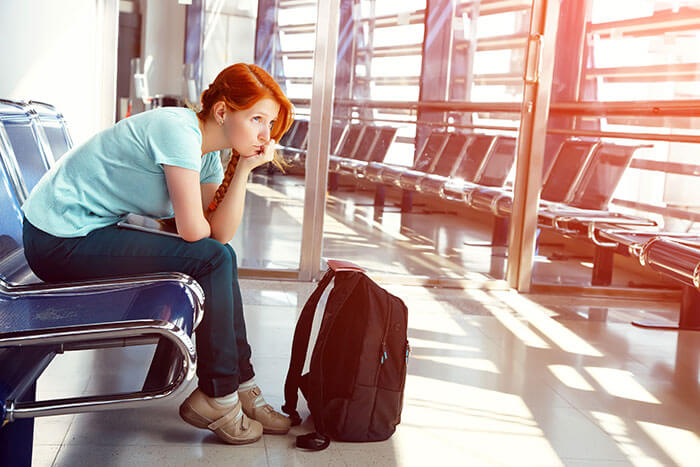 woman-sat-in-airport-delayed-flight