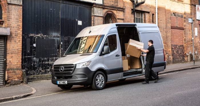 man loading a mercedes sprinter van