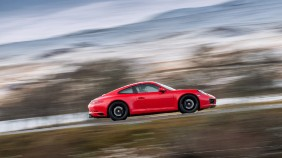 Automatic porsche driving through the countryside