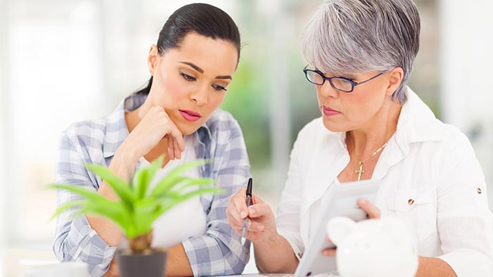 Mother and daughter looking at finances together