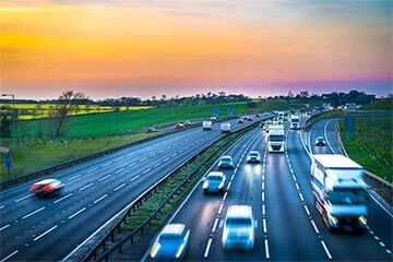 Cars on the motorway during sunset