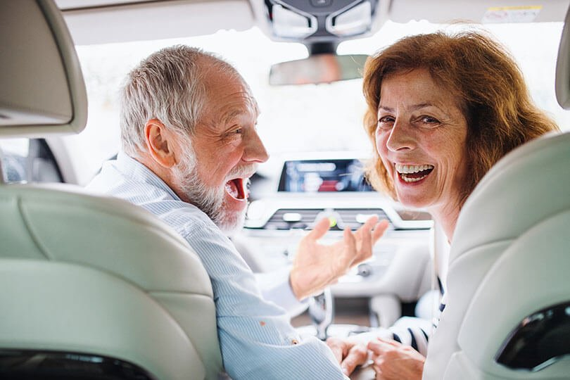 Couple happy and smiling in a car