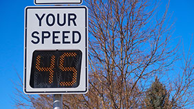 Digital speed indicator sign showing a speed of 45 mph