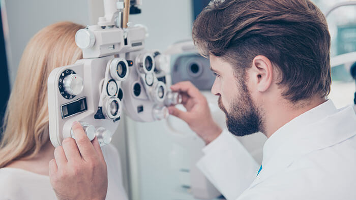Optician conducting an eye test on a patient