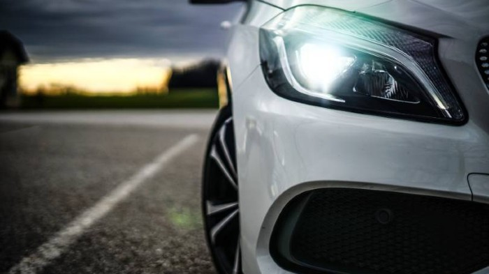 Close up of a car headlight at dusk