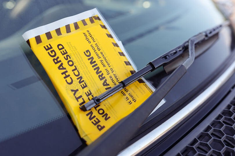 Parking charge notice attached to car windscreen