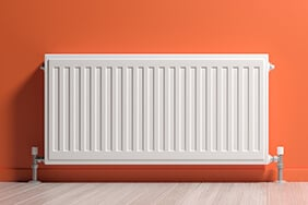 radiator on peach wall