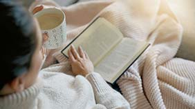 Person cosy with a book