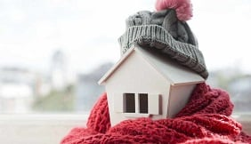 House wrapped in scarf and woolly hat