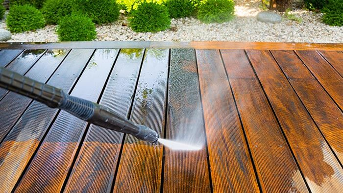 Pressure washing a garden deck