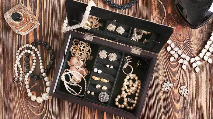 Jewellery box with a selection of jewellery strewn about