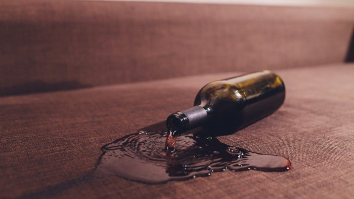 red wine spilled on sofa