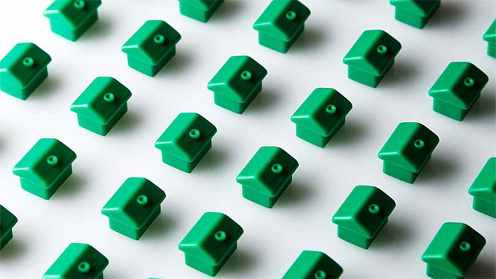 Row of green toy houses