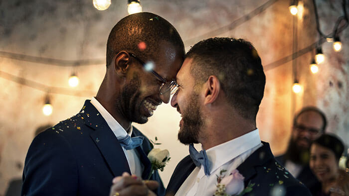 Two grooms dancing on their wedding day