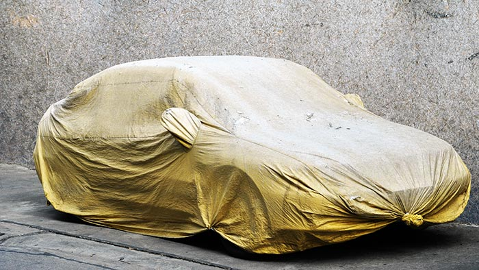 Car covered over in yellow cloth