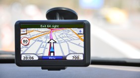 Sat nav being used attached to car windscreen