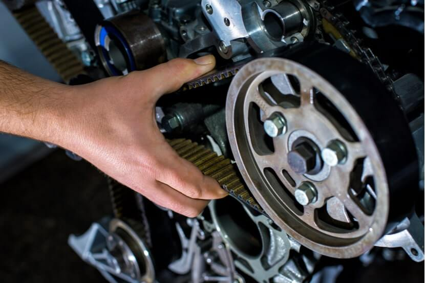 Mechanic changing a timing belt on a car