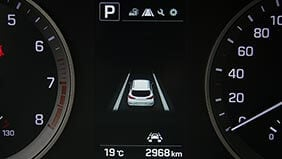 Lane departure warning light on a car dashboard