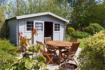 Shed with patio furniture outside