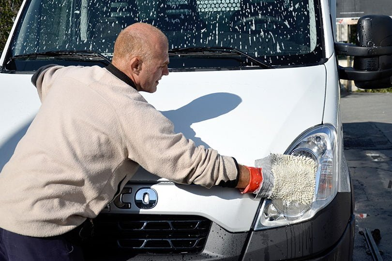 Cleaning a van with a wash mitt
