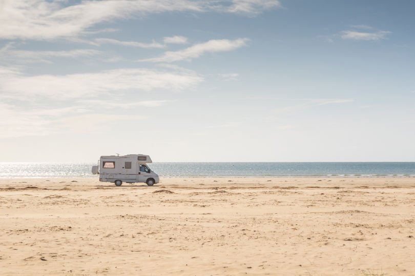 A motorhome on a beach