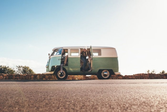 Side view of a campervan with people outside it