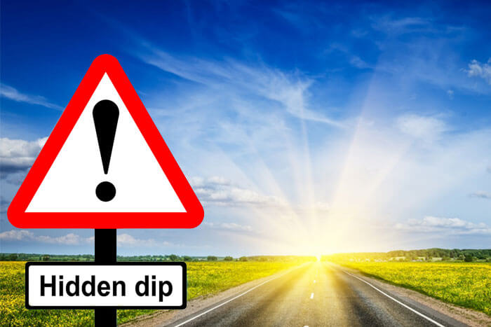 Hidden dip road sign